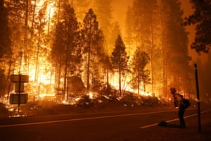 A firefighter watches the blaze from state highway 168