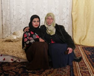 Umm Mohammed and her new 13-year-old daughter-in-law, on the marital bed she put together for the couple.
