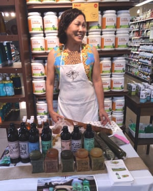 Unchon Ramos with a display of Virginia First Tea Farm products at a Whole Foods store in Newport News, Virginia.