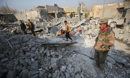Iraqis inspect the damage at a site in the Hamam al-Alil area, about 14 kilometres from the southern outskirts of Mosul.