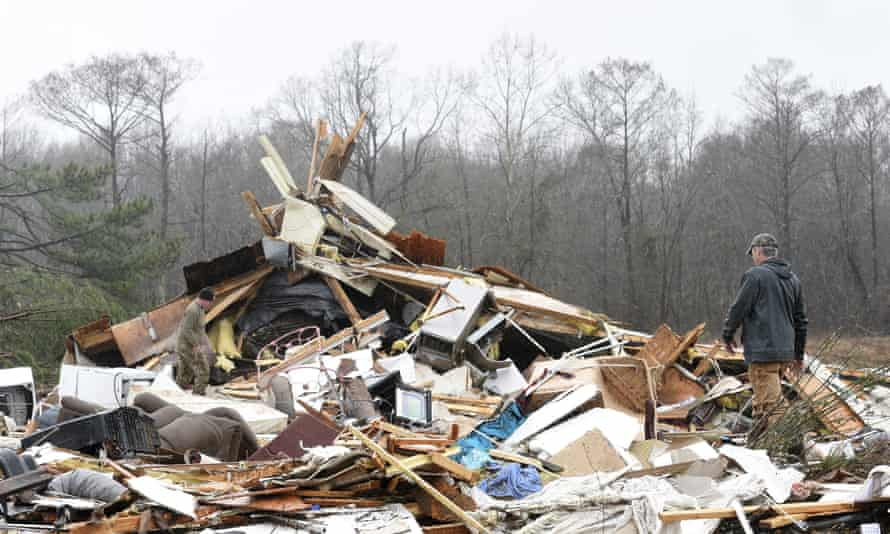 A family member searches through the remains of the home in Benton, Louisiana.