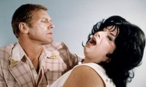 Tab Hunter and Divine in a still from Polyester (1981).