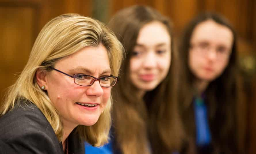 Justine Greening and girls in background