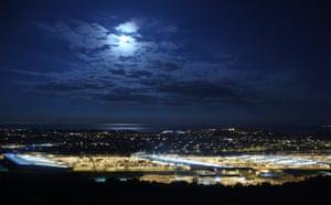 Moon illuminates the Eurotunnel terminal in UK