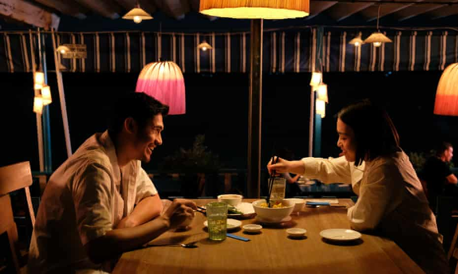 Molly Harris, right, with Henry Golding in Monsoon.