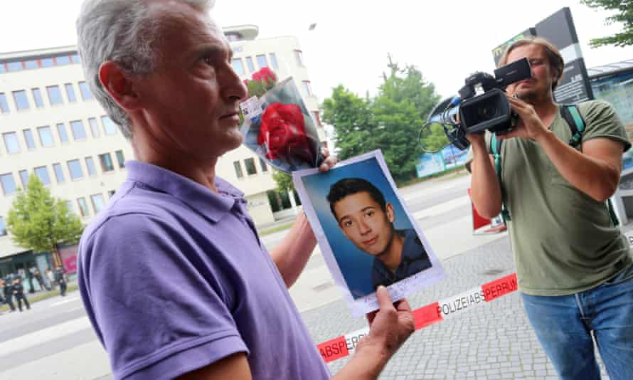 Naim Zabergja holds a photograph of his son Dijamant, who was killed in the Munich massacre.