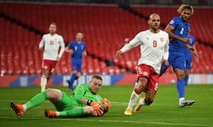 England goalkeeper Jordan Pickford beats Denmark's Martin Braithwaite to the ball.