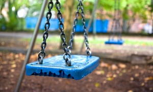 A blue swing in a child's playground