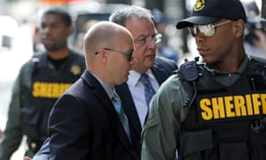 Lt Brian Rice, second from left, one of the six members of the Baltimore police department charged in connection to the death of Freddie Gray, arrives to court last week.
