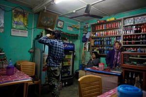 Young men drink whisky at a bar in Thimphu.