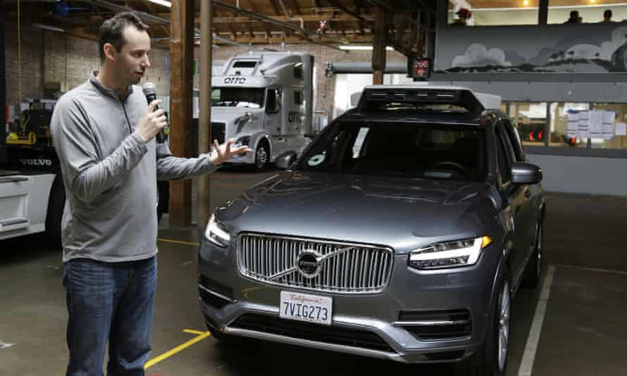 Anthony Levandowski discusses Uber's self-driving cars in San Francisco. An Otto truck can be seen in the background.