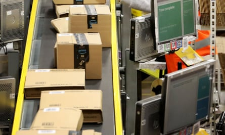 Staff label and package items at an Amazon warehouse.