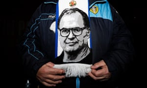 A Leeds fan shows off his Marcelo Bielsa scarf. The Argentinian has led Leeds to the top of the Championship, seven points ahead of third place.