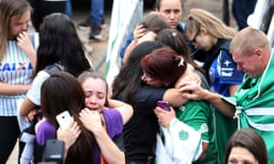 Fans of Chapecoense soccer team react in front of the Arena Conda stadium in Chapeco, Brazil.