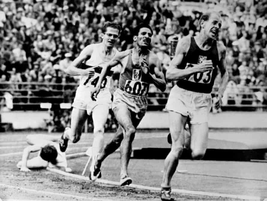 Zatopek leads Alain Mimoun and Herbert Schade and Chris Chataway during the Olympic 5000m in Helsinki