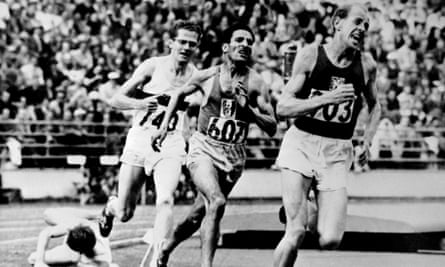Emil Zatopek leads the 5,000m final at the Helsinki Olympics in 1952 from Alain Mimoun and Herbert Schade with the faller Chris Chataway down on the track.