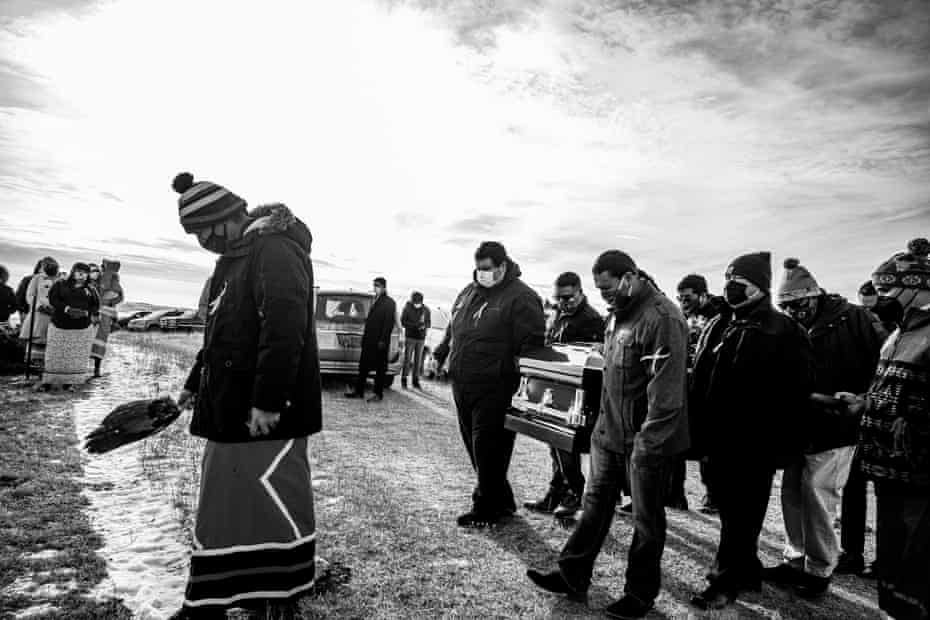 """The death of husband and wife Jesse """"Jay"""" and Cheryl Taken Alive delivered a major blow to the clan and the Standing Rock Tribe. They were buried on a family plot south of Cannon Ball, North Dakota. overlooking the Missouri River. Photographs made with the consent of the family. Coverage of COVID-19 on the Standing Rock Indian Reservation."""