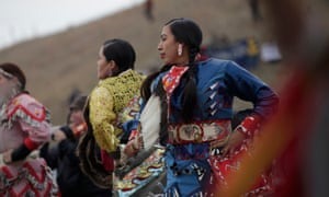 Native American dancers perform during a peaceful demonstration near the Dakota Access pipeline construction site.