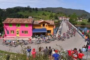 Fans watch the peloton pass through on Stage 18, a 169km trip from Suances to Santo Toribio de Liébana