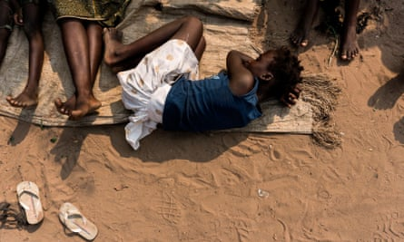 A woman rests at a camp for people fleeing conflict in the Congolese province of Kasai