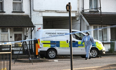 Police at Palmerston Road, Wealdstone, in north-west London