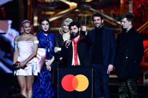 Yannis Philippakis, Jack Bevan, Jimmy Smith and Edwin Congreave of the band Foals accept the best group award.