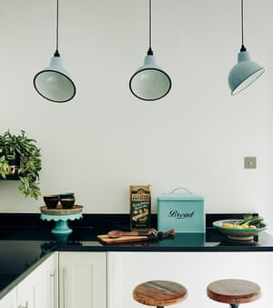 Turquoise pendant lights in the kitchen, from artifact-lighting.com.