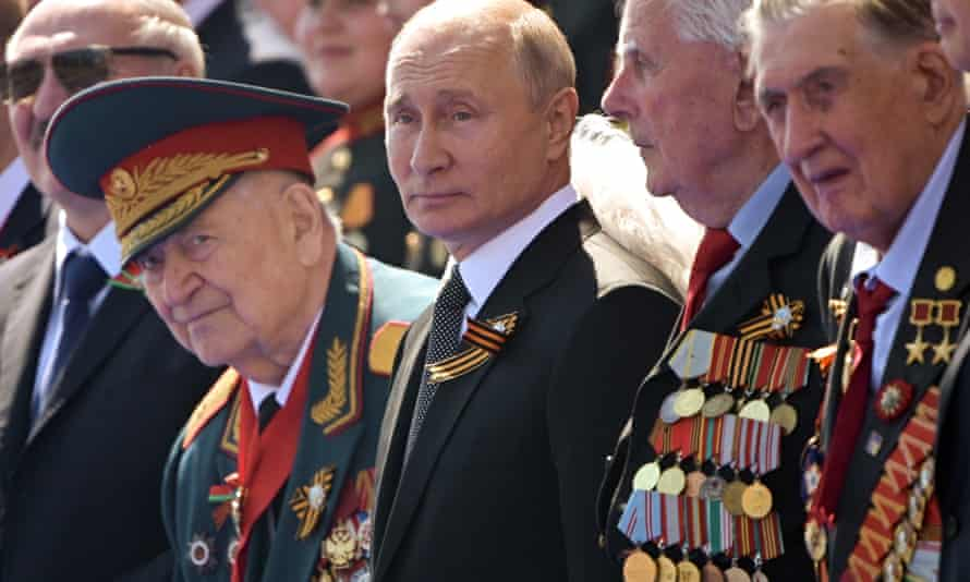 Vladimir Putin watches a parade in Moscow