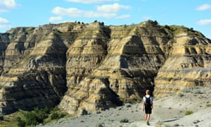 Mikah Meyer hiking the Caprock Coulee Trail in North Dakota's Theodore Roosevelt National Park.
