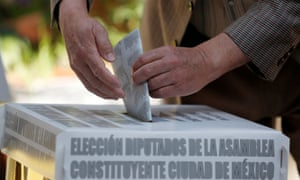 A man cast his ballot during the election of 60 deputies in Mexico City, Mexico on 5 June 2016.
