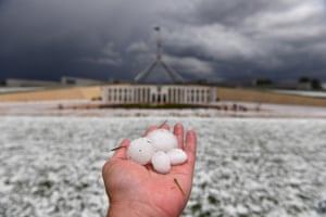 Canberra, Australia. Huge hailstones cover the ground the outside Parliament House after a storm