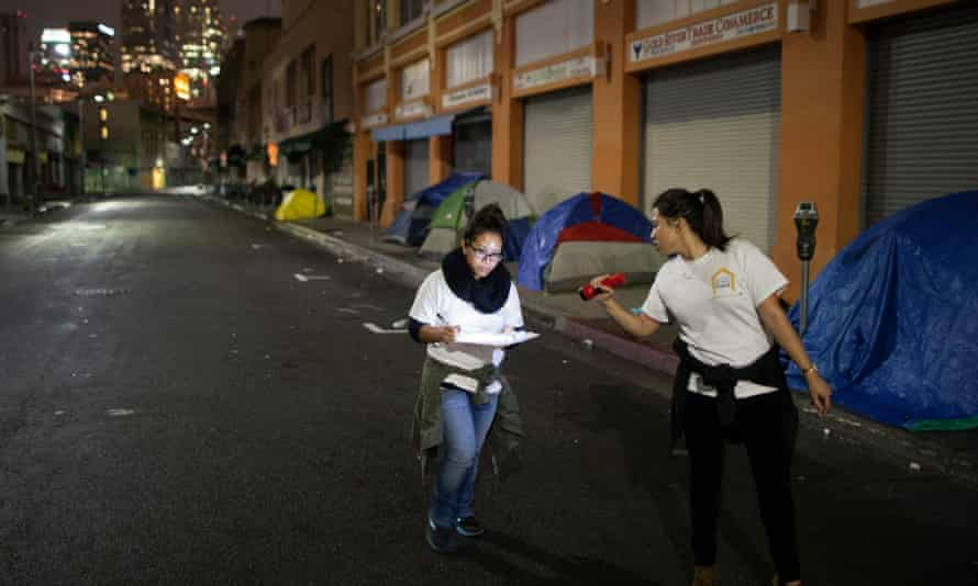 Volunteers count homeless people on a dark street in Skid Row, during the 2015 Greater Los Angeles homeless count.