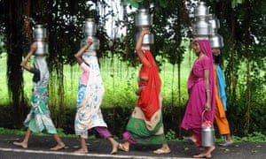 Women carrying water near the Sardar Sarovar Narmada dam – one of India's most controversial projects.