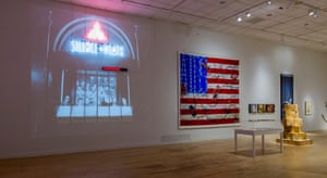An installation view of Art Aids America with Act-Up's Let the Record Show on the left.
