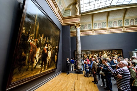 Visitors looks at Rembrandt's the Night Watch in the Rijksmuseum in Amsterdam.