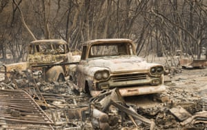 Trucks burned by a wildfire rest in a grove near Oroville. The fast-moving wildfire in the Sierra Nevada foothills destroyed structures, including homes, and led to several minor injuries