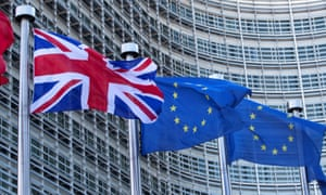 A union jack flutters next to EU flags at the EU Commission headquarters in Brussels