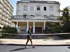 A woman walks past a cordoned-off building in Varosha.