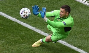Ukraine's Georgi Bushchan saves a penalty taken by North Macedonia's Ezgjan Alioski before Alioski scored their first goal from the rebound.