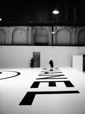 Karl Lagerfeld above the Chanel logo during the Haute Couture Fall:Winter 2004:2005 show at the Ateliers Berthier, Paris