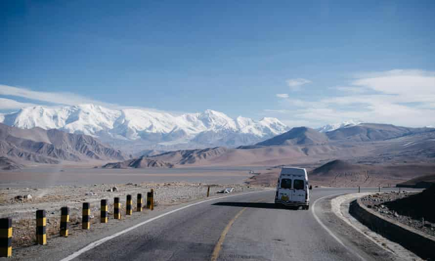 Road after crossing the Pakistan-China border. Pamir mountains in the distance.