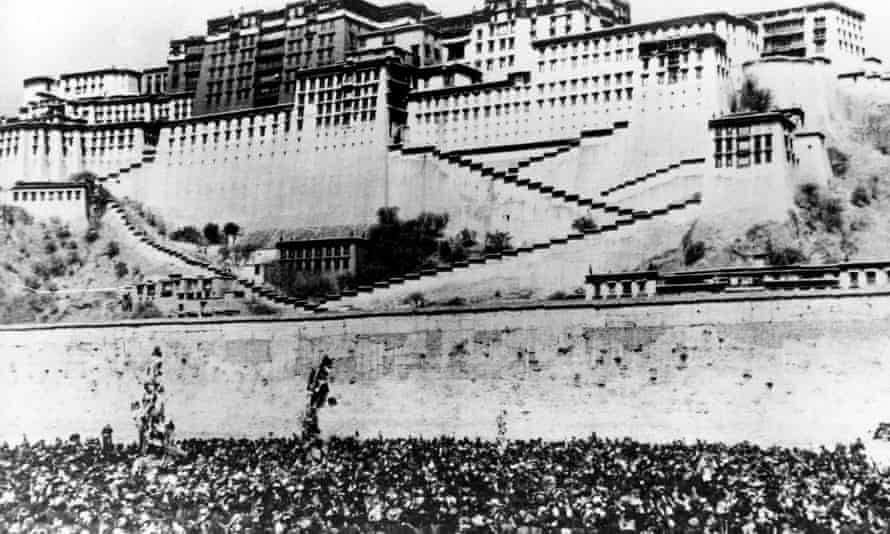 Thousands of Tibetan women silently surround the Potala Palace, the main residence of the Dalai Lama in Lhasa, to protest against Chinese rule and repression, 17 March 1959.