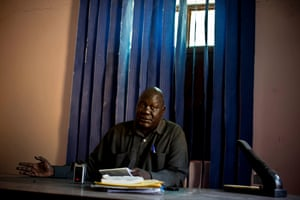 Elia Biech, the deputy mayor of Malakal sits behind his desk at the local government office in Malakal