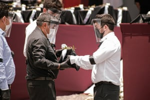 A man receives the ashes of a relative during the ceremony