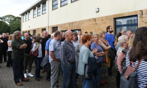 Residents from Whaley Bridge queuing at a school in Chapel-en-le-Frith, where the meeting took place.