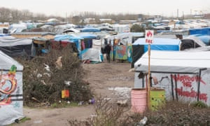 People walk in the so-called Jungle camp in Calais.