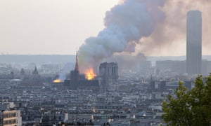 Plumes of smoke from the Notre Dame fire billow out over Paris.