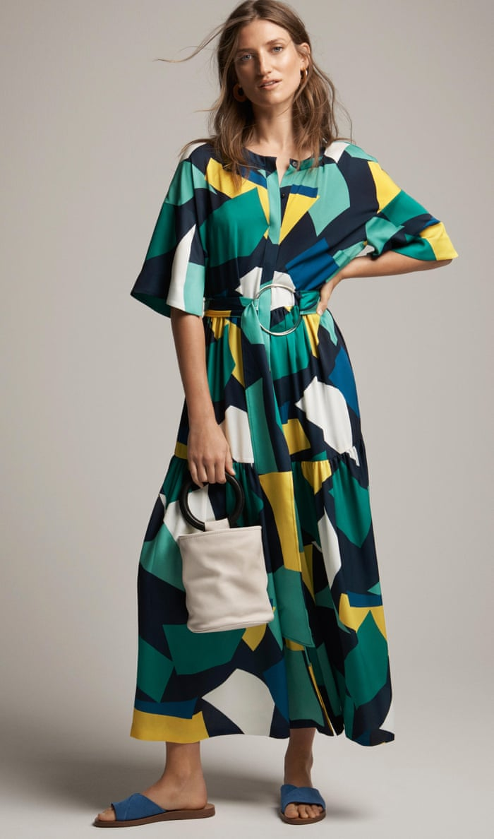 A model wears a colour-block geometric-print maxi dress.