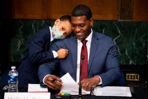 Washington DC, US: The nominee for administrator of the Environmental Protection Agency, Michael Stanley Regan, is hugged by his son Matthew at the conclusion of his confirmation hearing