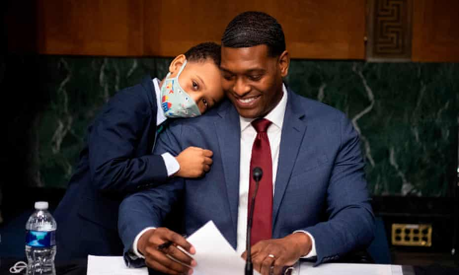 Michael Regan with his son Matthew at the end of his Senate hearing in February. 'We definitely feel the responsibility – we aren't going to shrink away from our obligations,' he told the Hlcarpenter.com.